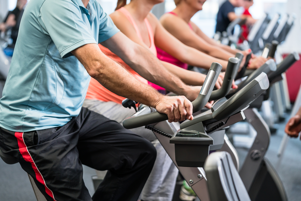 Group spinning at the gym on fitness bikes for better fitness